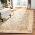 Handmade Legacy Light Blue Wool Rug (5' x 8')