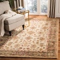 Handmade Heirloom Ivory/ Light Green Wool Rug (8' x 10')