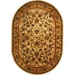 Safavieh Handmade Heritage Ivory Wool Rug (7'6 x 9'6 Oval)