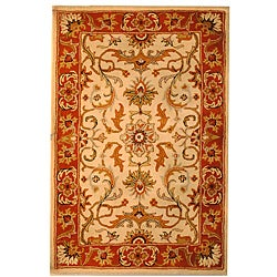 Indo Hand-tufted Beige/ Rust Wool Rug (5' x 8')