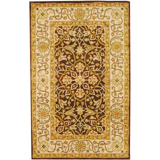 Indo Hand-tufted Brown/ Ivory Wool Rug (5' x 8')
