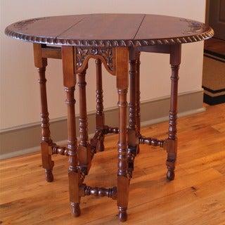 International Caravan Hand-Carved Mahogany Drop-Leaf Oval Table