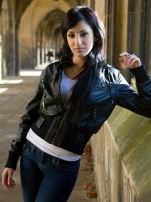 Woman wearing a leather motorcycle jacket