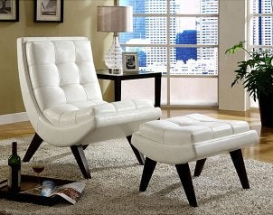 Modern white leather chair with matching ottoman