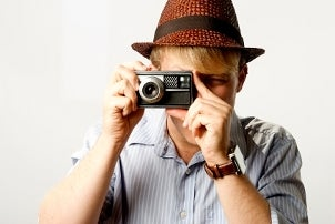 Hipster guy taking photos