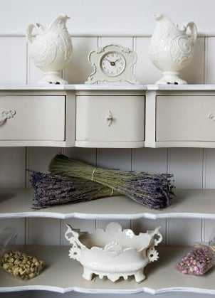 White clock with matching home decor