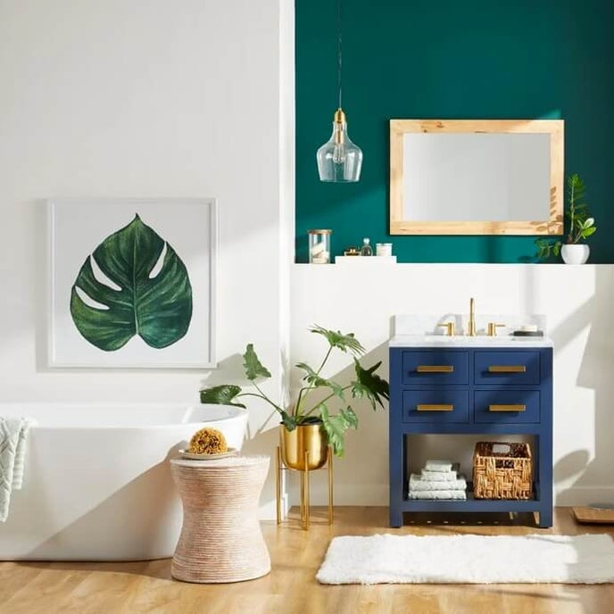 A two tone bathroom designed with eloquent blue single vanity, a white free standing tub and many other wall décor items. Shop at Overstock.com today.