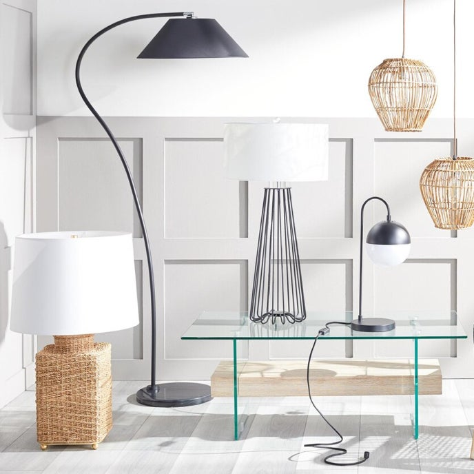 A showcase of unique lamps made from metal and wicker with a contemporary aesthetic available online at Overstock
